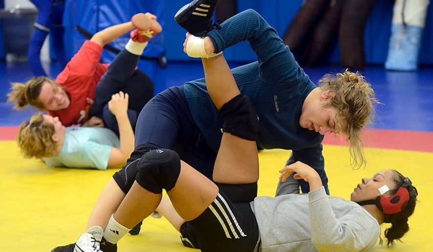 Helen Maroulis (shown above), a wrestler from Rockville, Md., may be the best U.S. wrestler in her weight class.    Maroulis won the U.S. Open Wrestling Championships last December and has a bye into the finals of the Olympic Trials on Saturday. (Bryan Oller/Special to the Washington Times)