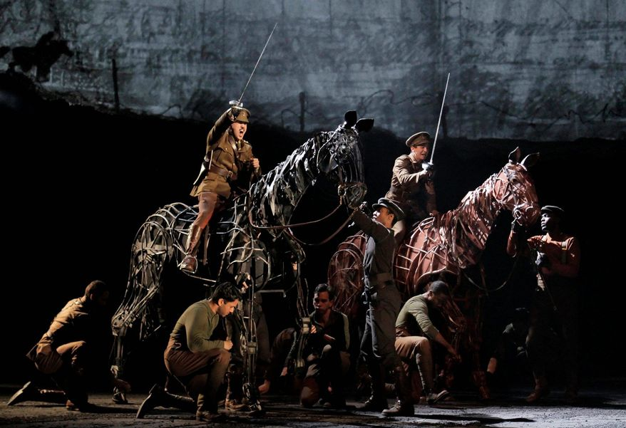 "FILE - In this theater publicity image released by Lincoln Center Theater, a scene is shown from the production of ""War Horse,"" performing at the Lincoln Center Theater in New York. Best-selling author Michael Morpurgo, who wrote the book the Tony Award-winning play is based on, was part of more than a dozen actors watching the auctioning-off of the horse Joey at the top of the show. The author, who made a similar appearance in the London production of ""War Horse"" and is an extra in Steven Spielberg's movie version, didn't speak any dialogue and didn't appear again until the curtain call a few hours later. (AP Photo/Lincoln Center Theater, Paul Kolnik)"