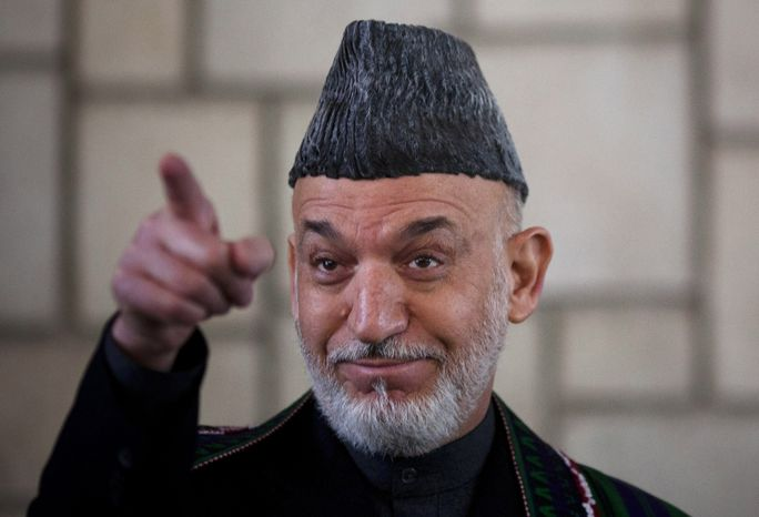 Afghan President Hamid Karzai gestures during a news conference in Kabul, Afghanistan, on Tuesday, March 6, 2012. (AP Photo/Anja Ni