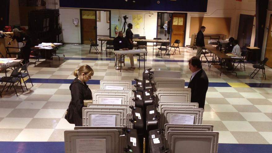 Voters cast their ballots at the Sarah Smith Elementary School in Atlanta's North Buckhead area on March 6, 2012.  (Associated Press)