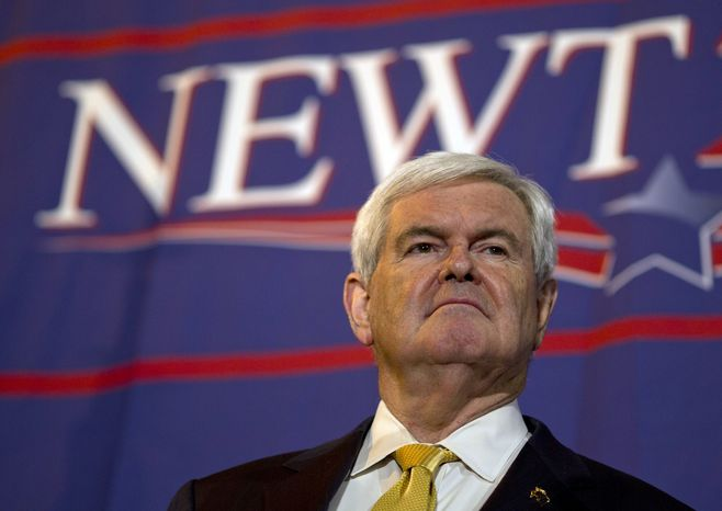 Former House Speaker Newt Gingrich pauses during a presidential campaign stop at Food City in Chattanooga, Tenn., on Monday, March 5, 2012. (AP Photo/Evan Vucci)