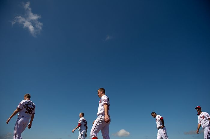 Washington Nationals players head to the locker room at the conclusion of practice during spring training at Space Coast Stadium, Viera, Fla., Tuesday, February 28, 2012. (Andrew Harnik/The Washington Times)