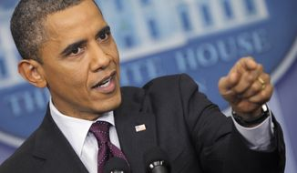 ** FILE ** President Obama points toward a reporter during a news conference at the White House in Washington, Tuesday, March 6, 2012. (Associated Press)