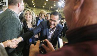 Mitt Romney greets supporters at Taylor-Winfield Technologies in Youngstown, Ohio. The GOP presidential candidate pushed his theme of more jobs and smaller government. (Associated Press)