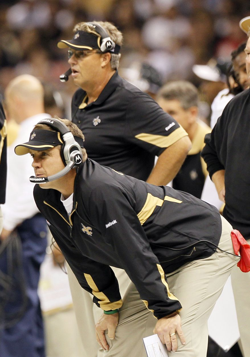 "FILE - In this Sept. 26, 2010, file photo, New Orleans Saints head coach Sean Payton, foreground, and defensive coordinator Gregg Williams, background, look on during an NFL football game at the Louisiana Superdome in New Orleans, La. Saints coach Sean Payton and general manager Mickey Loomis have taken ""full responsibility"" for the bounty program run by former assistant coach Gregg Williams. In a statement released Tuesday, March 6, 2012, Payton and Loomis admit violations of league rules ""happened under our watch."" They also promised it would never happen again. (AP Photo/Patrick Semansky, File)"