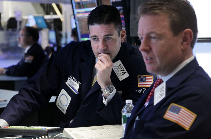 Traders work on the floor of the New York Stock Exchange on Tuesday, March 6, 2012, in New York. (AP Photo/Seth Wenig)
