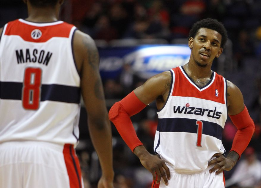 Washington Wizards guard Nick Young (1) reacts during play against the Golden State Warriors during the fourth quarter of an NBA game at Verizon Center in Washington, on Monday, March 5, 2012. The Warriors won 120-100. (AP Photo/Jacquelyn Martin)