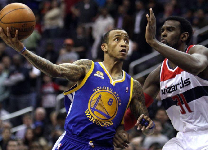 Golden State Warriors guard Monta Ellis (8) puts up a shot as he is guarded by Washington Wizards forward Chris Singleton during the first quarter of an NBA game at Verizon Center in Washington, on Monday, March 5, 2012. The Warriors won 120-100. (AP Photo/Jacquelyn Martin)