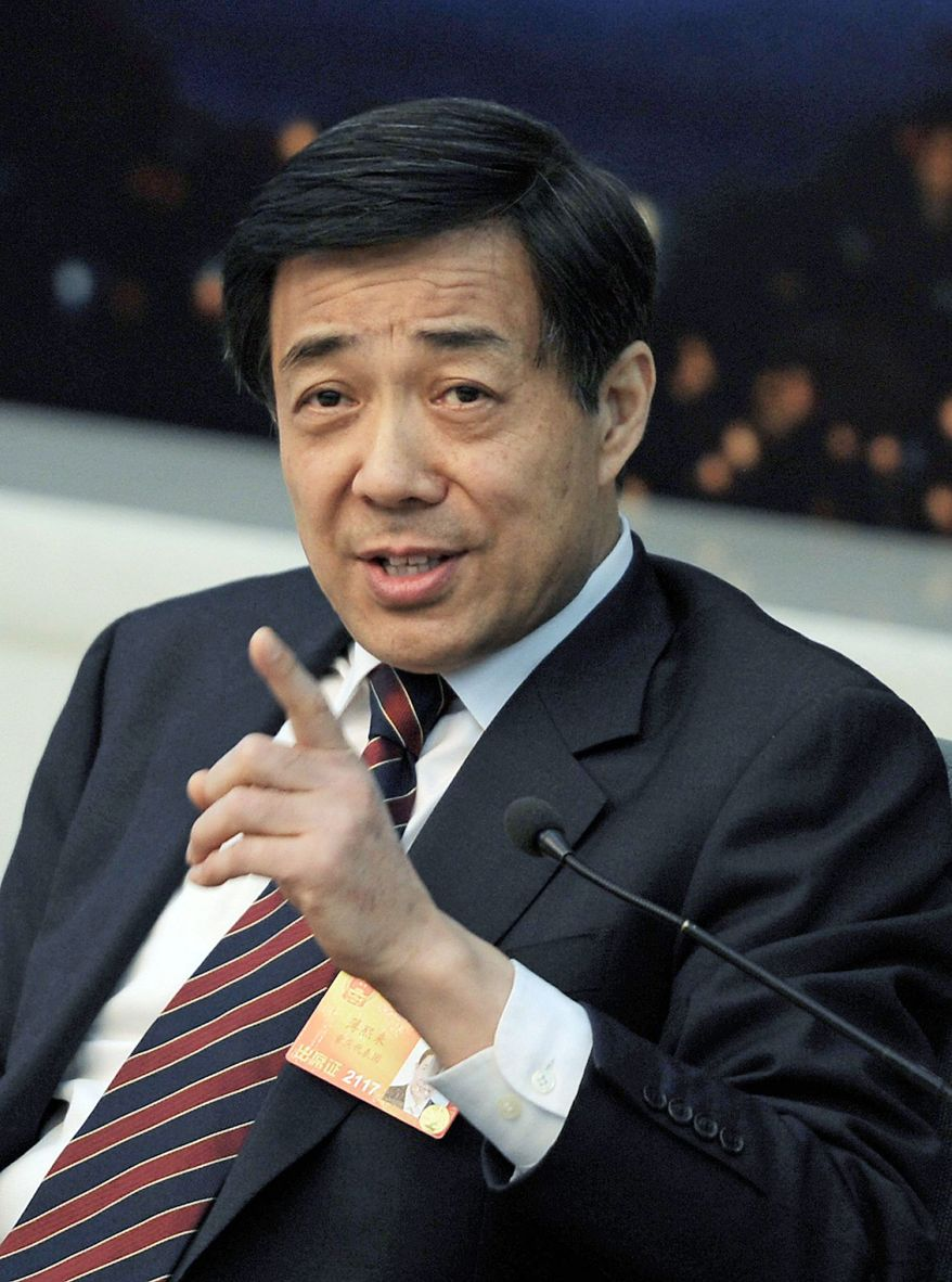 Bo Xilai, party secretary of the western city of Chongqing, speaks during a news conference after a Chongqing delegation meeting of the National People's Congress at the Great Hall of the People in Beijing, Saturday, March 6, 2010. Bo is the rare official in China with a strong public personality, which could help him with media and popular attention but might not help him within the upper levels of the conservative, ruling Communist Party. (AP Photo/Andy Wong)