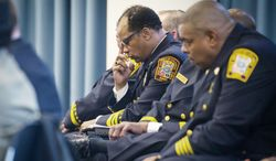 D.C. Fire Chief Kenneth Ellerbe keeps to himself before his testimony at the John A. Wilson Building in Washington, D.C., on Wednesday before the D.C. Council's Committee on the Judiciary to answer questions about a number of ongoing issues within the department. (Rod Lamkey Jr./The Washington Times)