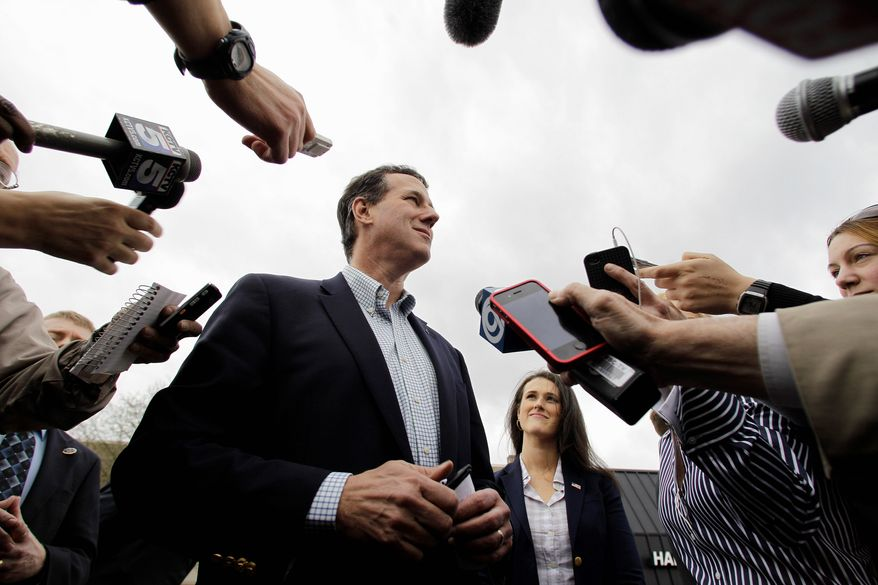 Rick Santorum, campaigning with his daughter Elizabeth in Lenexa, Kan., wasted no time using the issue of health care mandates against Mitt Romney, his toughest rival in the Republican presidential nominating contests. (Associated Press)
