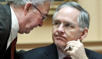Sen. Walter A. Stosch (left), chairman of the Senate Finance Committee, confers with Senate Majority Leader Thomas K. Norment Jr. during Wednesday's floor session. With adjournment set for Saturday, there is no agreement on a budget. (Associated Press)