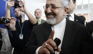 Ali Asghar Soltanieh, Iran's ambassador to the International Atomic Energy Agency (IAEA), is surrounded by media upon arriving March 7, 2012, at the International Center in Vienna, Austria, for the IAEA board of governors meeting. (Associated Press)