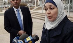 Nadia Kahf (right), executive director of the New Jersey chapter of the Council on American-Islamic Relations, and Aref Assaf, president of the American Arab Forum, speak to the media March 3, 2012, as they leave a meeting with federal and state law enforcement officials at the Richard Hughes Justice Complex in Trenton, N.J. (Associated Press)