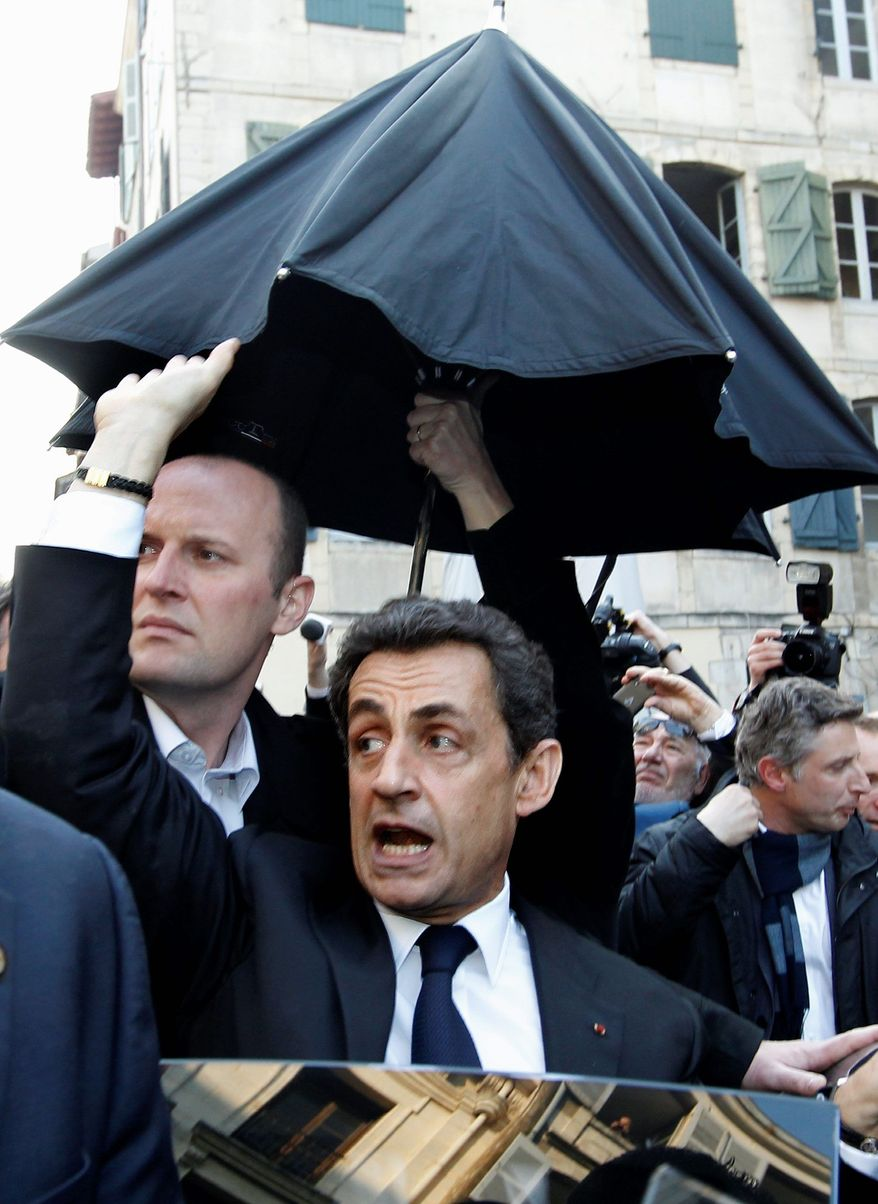 French President Nicolas Sarkozy, campaigning for re-election in the Basque city of Bayonne, took refuge last week when his visit was disrupted by a boisterous crowd. (Associated Press)