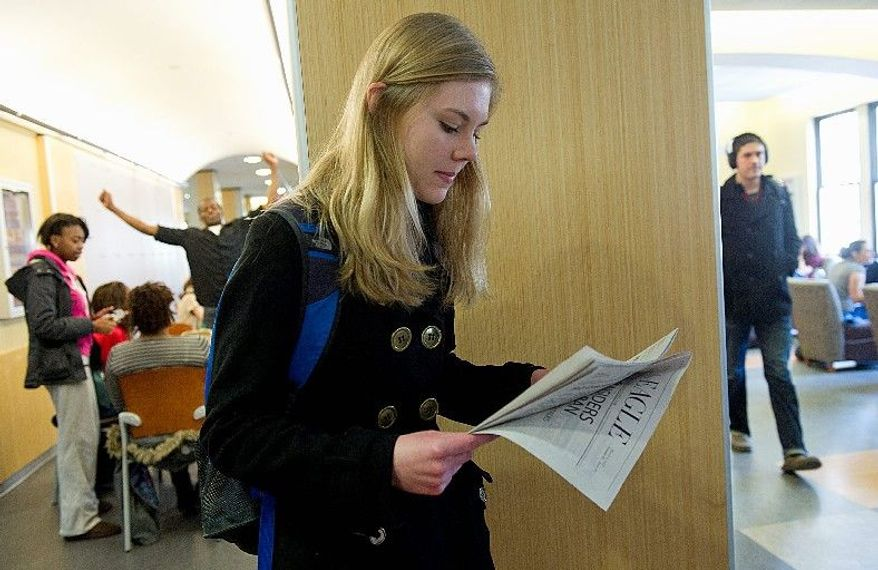 The print version of American University's newspaper the Eagle remains popular on campus. Freshman Lizzy Menstell, checking out the Tuesday issue, says she enjoys reading the Eagle grams - funny anecdotes in the print edition. (Barabara L. Salisbury/The Washington Times)