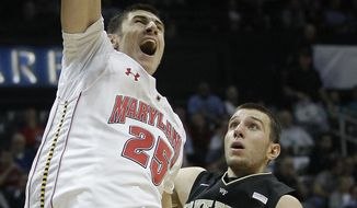 Maryland center Alex Len dunks the ball against Wake Forest center Carson Desrosiers in the second half of of the first-round Atlantic Coast Conference tournament game, Thursday, March 8, 2012, in Atlanta. (AP Photo/Chuck Burton)