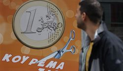 A pedestrian looks a shop sign that reads, ''One euro, price haircut,'' in Athens on Thursday, March 8, 2012. (AP Photo/Thanassis Stavrakis)
