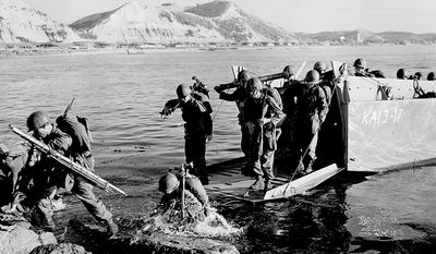 ** FILE ** Troops of the 1st U.S. Cavalry Division land ashore at Pohang on the east coast of Korea in July 1950 during the Korean War. (AP Photo, File)