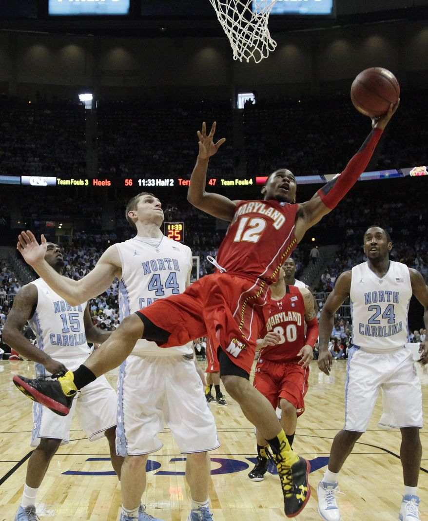 Maryland guard Terrell Stoglin shoots as North Carolina forward Tyler Zeller looks on during the second half in the quarterfinals of the ACC tournament, Friday, March 9, 2012, in Atlanta. North Carolina won 85-69. (AP Photo/Chuck Burton)