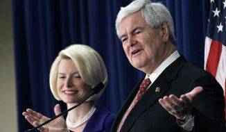 Republican presidential candidate and former House Speaker Newt Gingrich, accompanied by his wife, Callista, speaks March 8, 2012, at a rally in Jackson, Miss. (Associated Press)