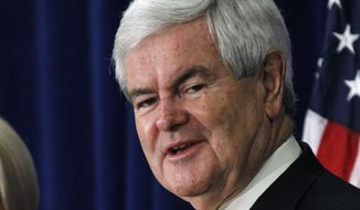 ** FILE ** Former House Speaker Newt Gingrich smiles during a March 8, 2012, rally in Jackson, Miss. (Associated Press)