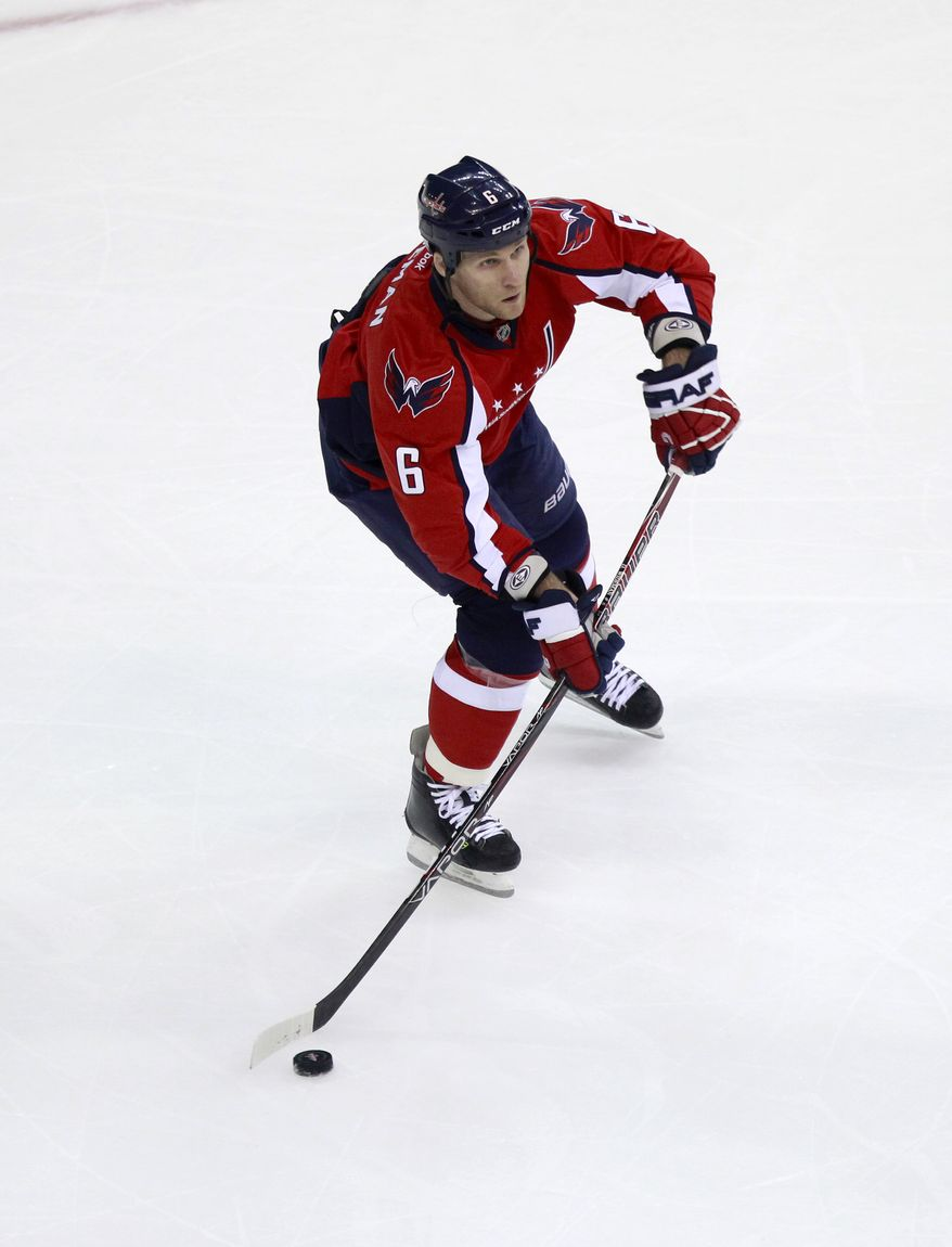 The Washington Capitals sent defenseman Dennis Wideman to the Calgary Flames in exchange for a fifth-round pick and the rights to impending free agent defenseman Jordan Henry. (AP Photo/Haraz N. Ghanbari)