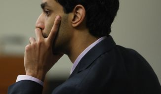 Former Rutgers University student Dharun Ravi listens March 8, 2012, during his trial in New Brunswick, N.J. Ravi is accused of using a webcam to spy on his roommate's intimate encounter with another man. (Associated Press/Home News Tribune)