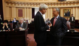 Senate Minority Leader Richard L. Saslaw, Fairfax Democrat, left, and Senate Majority Leader Thomas K. Norment, Jr., James City Republican, right, confer as the Senate met at the State Capitol in Richmond, Va. Thursday, March 8, 2012. The budget deadlock in the Senate continues. (AP Photo/Richmond Times-Dispatch, Bob Brown).