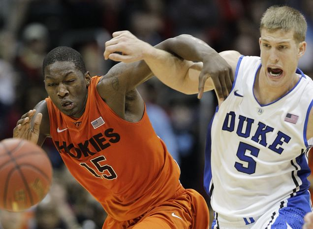 Virginia Tech forward Dorian Finney-Smith and Duke's Mason Plumlee vie for a lose ball during the second half in the quarterfinals of the Atlantic Coast Conference tournament, Friday, March 9, 2012, in Atlanta. Duke won 60-56. (AP Photo/Chuck Burton)