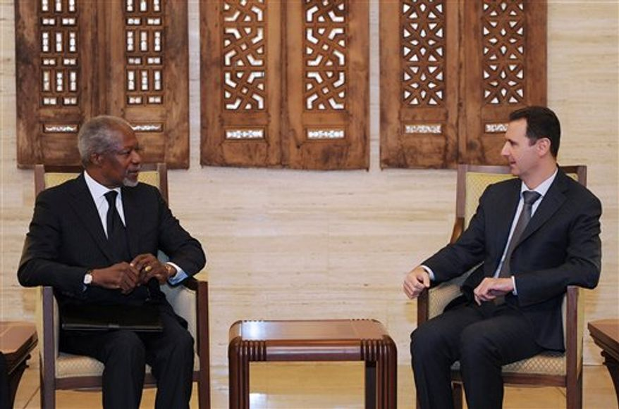 """In this photo released by the Syrian official news agency SANA, Syrian President Bashar Assad, right, meets with Kofi Annan, the United Nations special envoy to Syria, in Damascus, Syria, on Saturday March 10, 2012. The state-run news agency SANA reported that talks between Assad and Annan were """"positive"""" but there were no further details on the meeting. Syrian troops pushed ahead with a new assault on the northern region of Idlib on Saturday, shelling one of the centers of the uprising against President Bashar Assad's rule and sending families fleeing for safety as armed rebels tried to fend off the attack. Thick black smoke billowed into the sky. (AP Photo/SANA)"""