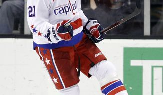 Washington Capitals' Brooks Laich celebrates his power-play goal in the second period against the Boston Bruins in Boston on Saturday, March 10, 2012. (AP Photo/Michael Dwyer)