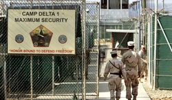 ** FILE ** In this June 27, 2006, photo, reviewed by the U.S. Department of Defense, U.S. military guards walk within the Camp Delta military-run prison at the Guantanamo Bay U.S. Naval Base in Cuba. (AP Photo/Brennan Linsley)