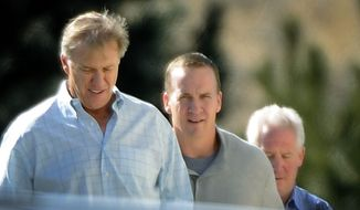 NFL quarterback Peyton Manning (left) takes a tour March 9, 2012, with John Elway, executive vice president of football operations for the Denver Broncos, and Broncos coach John Fox at the team's training facility in Englewood, Colo. (Associated Press/The Denver Post)