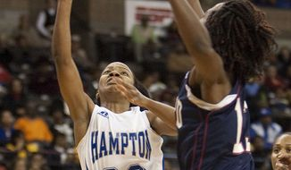 Hampton guard Jericka Jenkins shoots over Howard forward Saadia Doyle during the first half of the NCAA Mid-Eastern Athletic Conference women's college basketball tournament championship game in Winston-Salem, NC., on Saturday, March 10, 2012. (AP Photo/Lynn Hey)