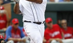 Detroit Tigers Prince Fielder bats against the Philadelphia Phillies during a spring training baseball game in Lakeland, Fla., Friday, March 9, 2012. (AP Photo/Paul Sancya)