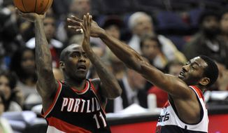 Portland Trail Blazers' Jamal Crawford goes up for the shot against the defense of Washington Wizards' John Wall during second half on Saturday, March 10, 2012, in Washington. Portland defeated Washington 110-99. (AP Photo/Richard Lipski)