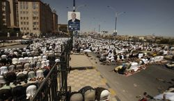 Protestors attend Friday prayers during a rally demanding the trial of Yemen's former President Ali Abdullah Saleh, in Sanaa, Yemen, Friday, March 9, 2012. (AP Photo/Hani Mohammed)