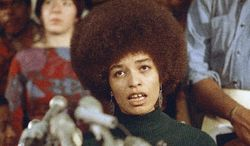 Angela Davis, seen here in February 1972 being freed on bail while awaiting trial for murder in the furnishing of guns used in a shootout at the Marin, Calif., County courthouse, was ultimately acquitted, despite her proven ownership of the murder weapons. (Associated Press)
