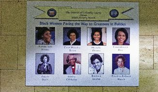 "A poster hanging on the wall in the D.C. Superior Court building in Washington, D.C. shows ""Black Women Paving the Way to Greatness in Politics."" It curiously includes Ms. Davis. (The Washington Times)"