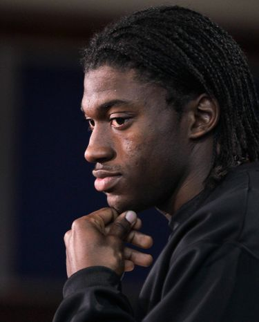 Baylor quarterback Robert Griffin III listens to a question during a news conference at the NFL football scouting combine in Indianapolis, Friday, Feb. 24, 2012. (AP Photo/Michael Conroy)