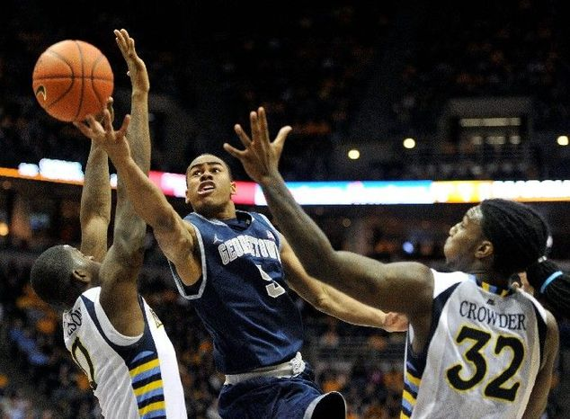 Georgetown sophomore Markel Starks, going to the basket against Marquette, is one of 10 underclassmen on the Hoyas' roster. (Associated Press)