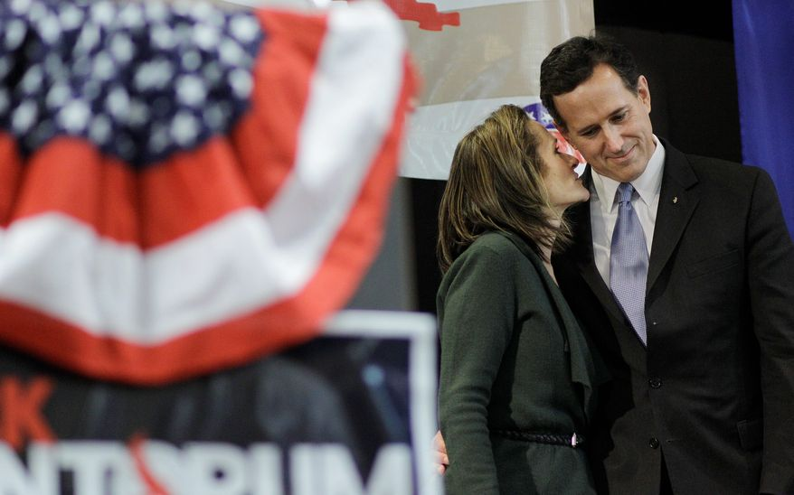 Republican presidential candidate Sen. Rick Santorum listens to his wife, Karen, as he is introduced during the Cape County Republican Women's Lincoln Day Dinner on Saturday in Cape Giradeau, Mo. He won the Kansas caucuses Saturday. (Associated Press)