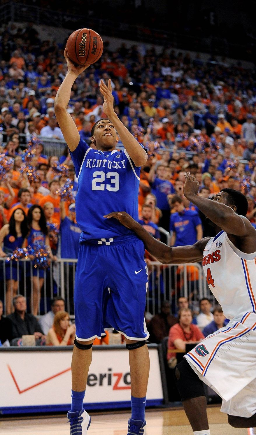 Kentucky's Anthony Davis shoots a 3-pointer as Florida's Patric Young (4) approaches during the second half of an NCAA college basketball game in Gainesville, Fla., Sunday, March 4, 2012. Kentucky defeated Florida 74-59. (AP Photo/Phil Sandlin)