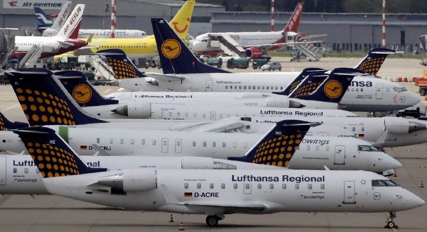 ** FILE ** Lufthansa airplanes park at the Duesseldorf airport in western Germany. (Associated Press)