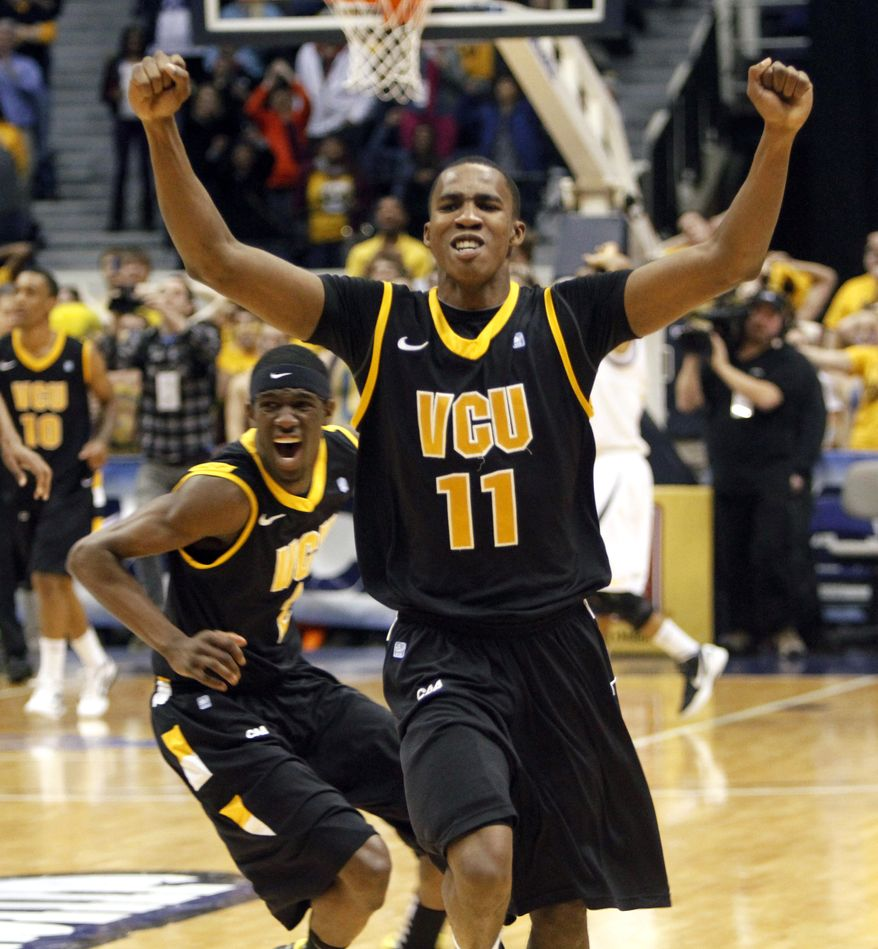 Virginia Commonwealth guard Rob Brandenberg (11) and Briante Weber (2) celebrate winning the Colonial Athletic Association Championship at the Coliseum in Richmond, Va., Monday, March 5, 2012. VCU defeated Drexel 59-56. (AP Photo/Steve Helber)
