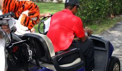 Tiger Woods is driven away in a cart after hitting off the 12th tee during the final round of the Cadillac Championship tournament on Sunday, March 11, 2012, in Doral, Fla. Woods withdrew from the tournament. (AP Photo/Wilfredo Lee)