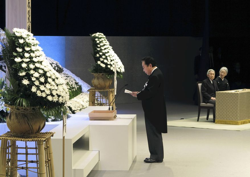 Japanese Prime Minister Yoshihiko Noda (left) gives a memorial address as Emperor Akihito (second from right) and Empress Michiko listen during the national memorial service for the victims of the March 11, 2011, earthquake and tsunami in Tokyo on Sunday, March 11, 2012. (AP Photo/Pool)