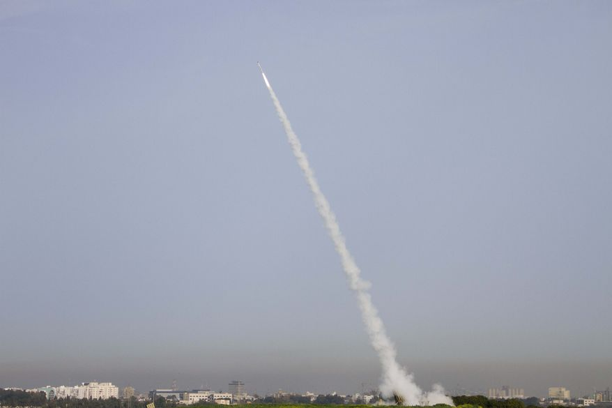 """The Israeli anti-missile system known as """"Iron Dome"""" launches a rocket in Ashdod, Israel, to intercept a missile fired by Palestinian militants from the Gaza Strip on Sunday, March 11, 2012. (AP Photo/Ariel Schalit)"""