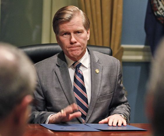 Virginia Gov. Bob McDonnell gestures as he talks with members of the Virginia General Assembly after the session adjourned at the Capitol in Richmond on Saturday, March 10, 2012. (AP Photo/Steve Helber)
